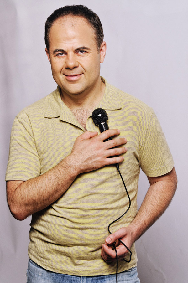 Yianni Zinonos, TVS Presenter, White background with mic, PR portrait