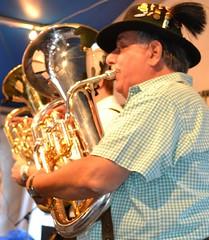 sousaphone(0.0), trumpet(0.0), musician(1.0), tuba(1.0), music(1.0), horn(1.0), brass instrument(1.0), wind instrument(1.0),