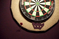 recreation(0.0), pattern(1.0), dartboard(1.0), indoor games and sports(1.0), sports(1.0), games(1.0), darts(1.0), circle(1.0),