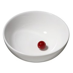 A red bead in a white bowl