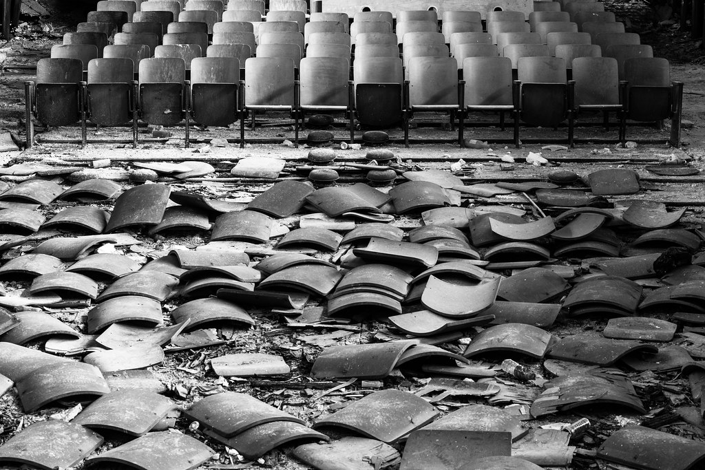 broken seats at an auditorium in an abandoned philadelphia high school