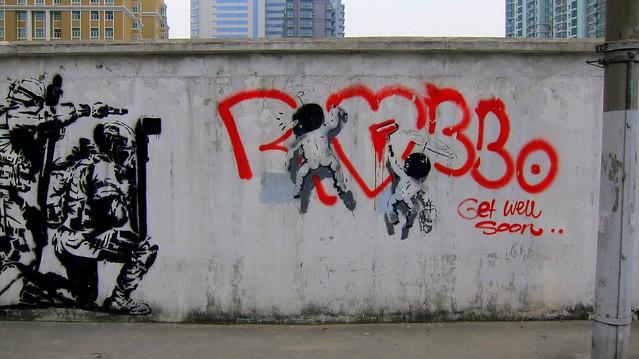 stencil shanghai 2012 - banksy vs robbo