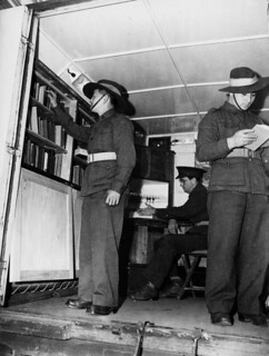 Soldiers browsing the shelves of the Army Education Service's Mobile Library, Brisbane, 1944