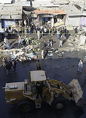 People gather at the scene of a car bomb attack in Zafaraniyah, Baghdad, Iraq, Friday, Jan. 27, 2012. by Pan-African News Wire File Photos