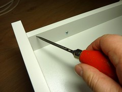Use a bradawl to indent and mark the screwholes