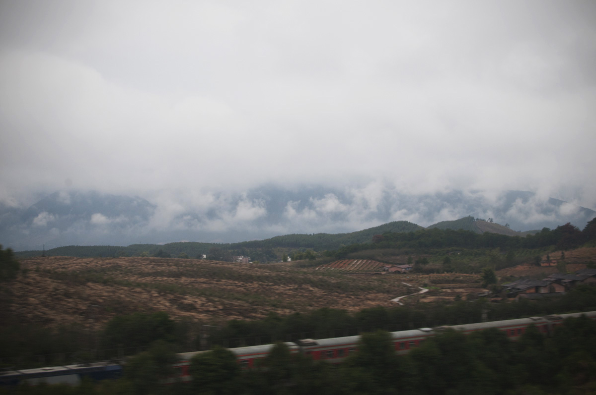 A view of the slow train traveling along the China countryside.