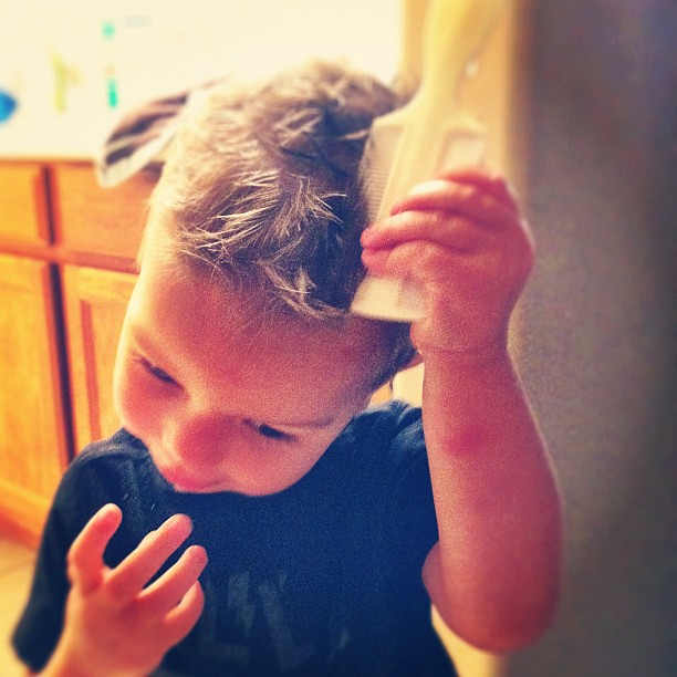 Loves to brush his hair like daddy!