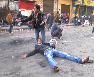 Protester appeals for help for a tear gas casualty - Mohamed Mahmoud Street - 4th February 2012.