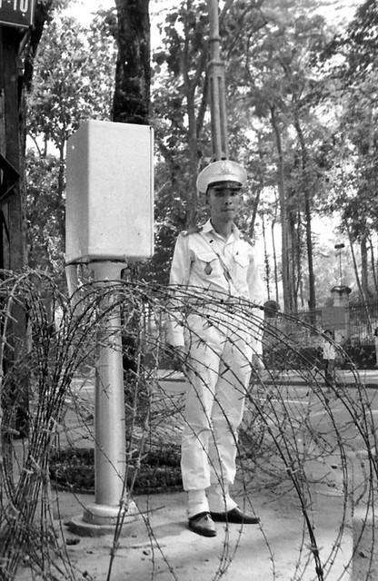 A Vietnamese officer at corner of Cong Ly and Hong Thap Tu St
