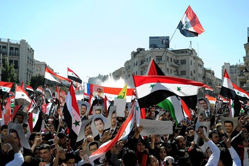 Supporters of the Syrian government of Bashar al-Assad. The government has been under attack by the US and other imperialist states. by Pan-African News Wire File Photos