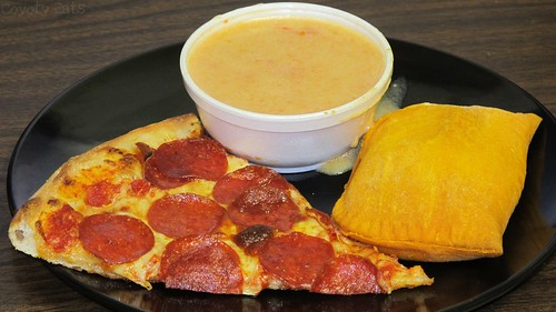 Pepperoni pizza, Jamaican beef patty, and carrot bisque by Coyoty