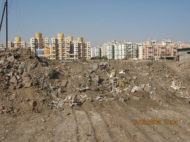 Debris & Magarpatta City - Visit Kumar Properties' Kumar Purab, 2 BHK & 3 BHK Flats, off Pune Solapur Road, behind Diamond Cars, Hadapsar, Pune 411 028