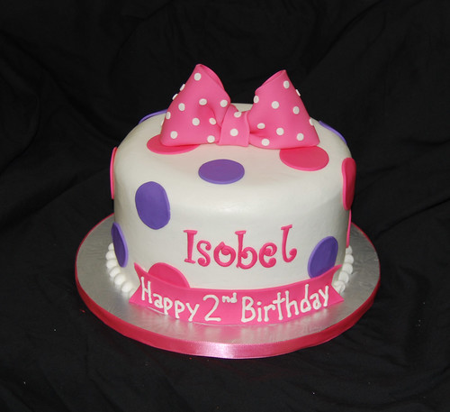 pink and purple 2nd birthday cake for a Minnie Mouse themed celebration