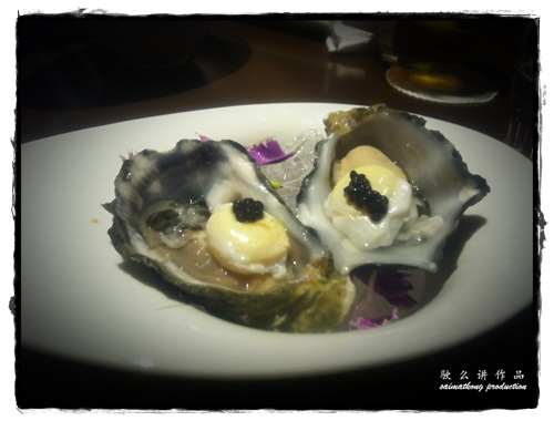 Coffin Bay oyster with poached quail egg and smoked caviar