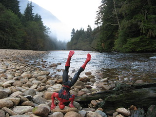 Spider-Man does a handstand by a riverbed