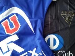 jacket(0.0), sports uniform(1.0), clothing(1.0), sleeve(1.0), outerwear(1.0), font(1.0), jersey(1.0), sportswear(1.0), brand(1.0),