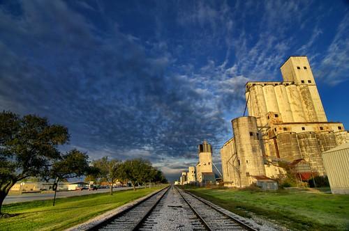 railroad clouds sunrise vanishingpoint texas katy silos railroadtracks katytexas smalltowntexas ricesilos