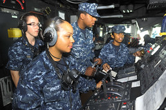 In this file photo, satch standers man the helm in the pilothouse of dock landing ship USS Pearl Harbor (LSD 52) while entering port in Singapore Ded. 23. (U.S. Navy photo by Mass Communication Specialist 2nd Class Jason Behnke)