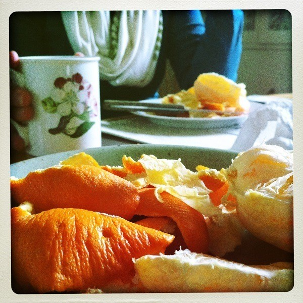 a breakfast of oranges and coffee