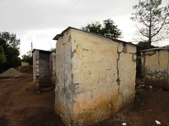 Old pit latrines in bad conditions