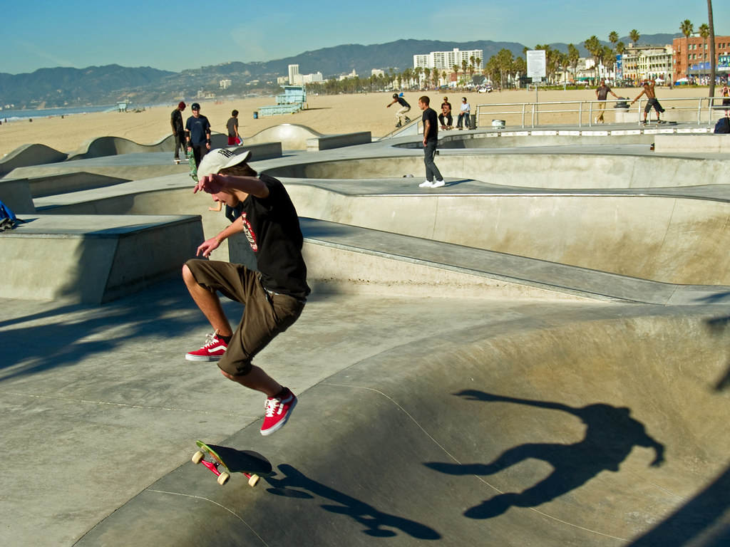 Skateboarder and shadow
