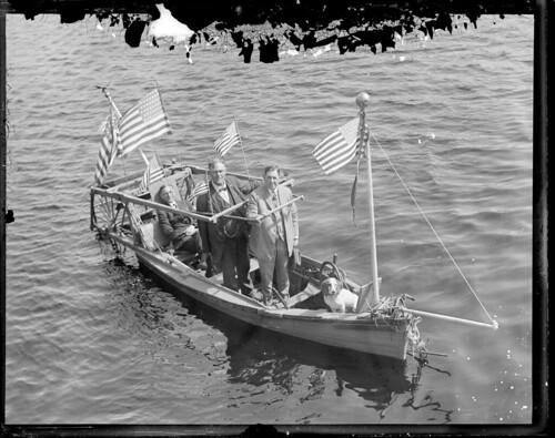 3, men, boat, flags