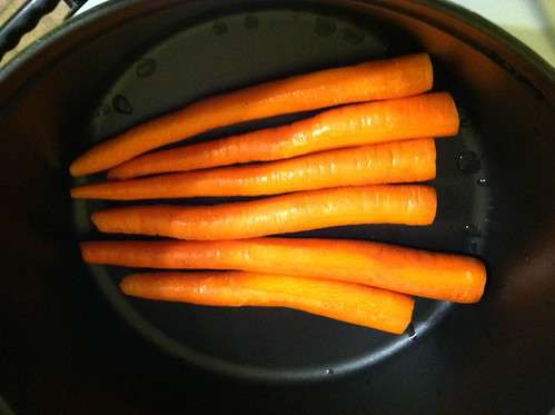 Layer the bottom of the Staub Oven with carrots