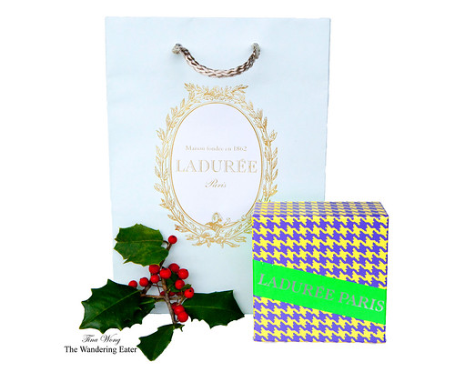 Ladurée's Pied de Coq box and signature pastel green and gold bag