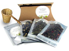 AOT award-winning tea set--pretty bags of tea displayed next to a cardboard sleeve and a honey dipper