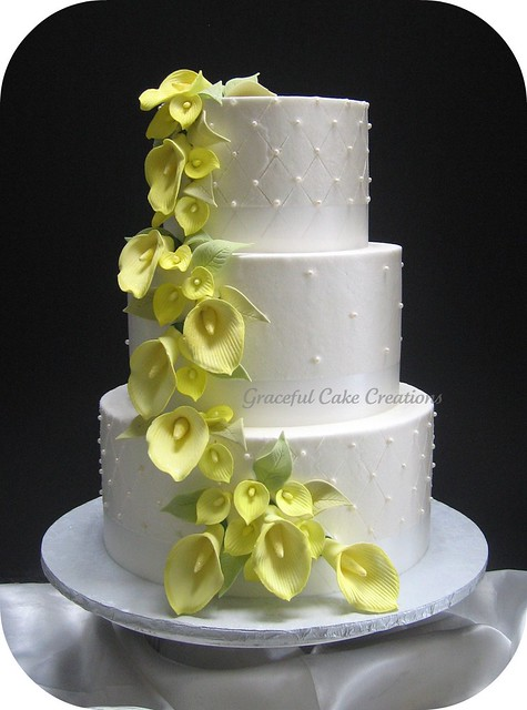 Elegant White Wedding Cake with Yellow Calla Lilies