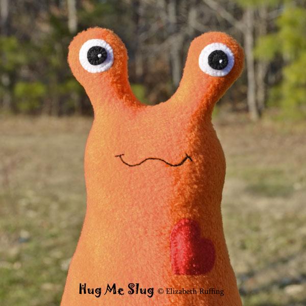 Orange Fleece Hug Me Slug, original art toys by Elizabeth Ruffing