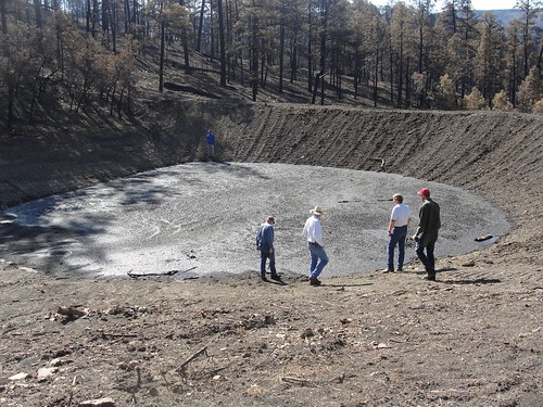 Assessing the Track Fire aftermath: NRCS New Mexico employee Brian Schwebke (far right), a member of the NRCS Damage Survey Report Team, and officials of the City of Raton, view a sediment pond. Assessing the Track Fire aftermath: NRCS New Mexico employee Brian Schwebke (far right), a member of the NRCS Damage Survey Report Team, and officials of the City of Raton, view a sediment pond.