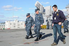 SASEBO, Japan (Jan. 23, 2012) Capt. David Fluker, commanding officer of the forward-deployed amphibious assault ship USS Essex (LHD 2) gives Rear Adm. Gerard P. Hueber, commander of Expeditionary Strike Group 3, a tour of the ship's flight deck during his visit. (U.S. Navy photo by Mass Communication Specialist 2nd Class William Jenkins)