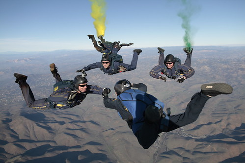 The U.S. Navy parachute demonstration team administers the oath of enlistment during a free fall jump.