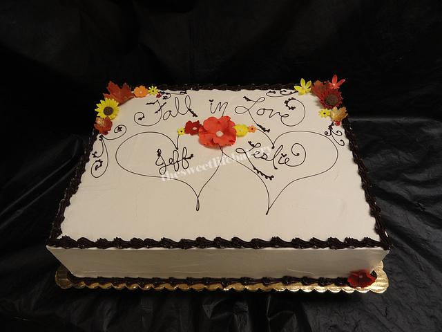 A simple sheet cake instead of a tiered cake for this fall themed wedding