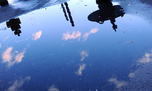 Rain puddle - reflections of the sky and clouds, garden statues, day, Dario's, Lake City Way, Seattle, Washington, USA by Wonderlane