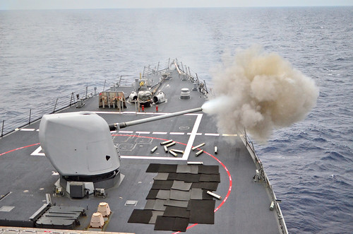 Guided-missile destroyer USS John S. McCain fires its 5-inch, .54-caliber gun during a high-speed maneuvering surface target exe