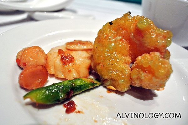 Individual portion of Min Jiang's almond prawn, served with scallop and macadamia nuts