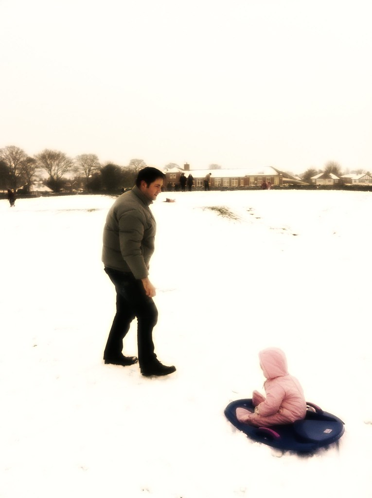 Nola and daddy playing in the snow 2