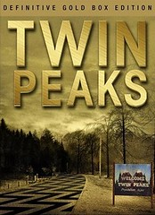 cover of the twin peaks box set--TWIN PEAKS is in gold letters and the picture is of the highway leading into town