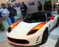 automobile(1.0), tesla(1.0), exhibition(1.0), tesla roadster(1.0), vehicle(1.0), performance car(1.0), automotive design(1.0), auto show(1.0), land vehicle(1.0), supercar(1.0), sports car(1.0),