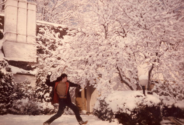 1977_January_Mike In Snow Ball Fight In Front Of Our House