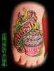 Gangster cupcake foot tattoo by Jackie Rabbit