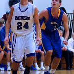 "Whitinsville Christian 85, Hopedale 63: Undermanned..By Jared Keene/Daily News staff..At 6-foot-6, senior Paul Manning is the main rebounder and inside threat on Hopedale's boys basketball team...Just 2:25 into last night's contest with Dual Valley Conference rival Whitinsville Christian, however, Manning picked up his second foul, earning him a spot on the bench for the rest of the half...The Crusaders took full advantage, out-rebounding the hosts by 18 in the first half while lighting it up from the field in a 85-63 victory...""If I didn't get those silly fouls at the beginning of the game, I felt like I would have played the whole first quarter, so that alone would have kept the rebounding up to par with the other team,"" Manning said. ""We wouldn't have been down so much.""..Hopedale coach Tony Cordani saw a variety of factors key the visiting Crusaders...""They came ready to play and I don't know what their percentage was in the first half, but they shot the ball extremely well,"" said Cordani after his team fell to 6-3 (2-1 DVC). ""And Paul got into a little foul trouble, so we couldn't rebound with them. The combination of their exceptional shooting in the first half and our lack of rebounding was the difference, I thought.""..Whitinsville Christian seemed to set the tone early by forcing a turnover and an airball on the Blue Raiders' first two offensive possessions...The Crusaders held a 19-9 lead after the first quarter, thanks in large part to their eight offensive rebounds — allowing for second-chance opportunities — and tough man-to-man defense that seemed to fluster the Hopedale offense...""One of our keys to the game was to win the rebounding battle tonight and keep them off the offensive glass and for the most part we did a pretty good job of that,"" Whitinsville coach Jeff Bajema said. ""We've also been working hard on our defense. We don't have the height this year, but we've got some quick guards and kids that like to defend. That's our game right now.""..In the second quarter, the Crusaders also started taking advantage of the various zone defenses the Blue Raiders played. Whitinsville Christian spread the floor and used quick, crisp ball movement to end up with numerous open 3-pointers...Of the seven triples the Crusaders hit for the game, five came in the second quarter, a period in which the visitors built their lead to 25 by halftime (50-25). Two of those five treys came from the hand of Colin Richey, who finished with a game-high 20 points...""I've seen these guys play on a number of occasions and the teams that have gone man-to-man (against them), Richey has been able to penetrate and then he becomes a problem,"" Cordani said of the decision to play zone. ""I was just hoping that we could weather the storm a little bit and have some in the tank at the end. It was a gamble we took. I guess we'll see what happens next time we play them.""..Hopedale came out a different team in the third quarter, out-rebounding Whitinsville by six while outscoring the Crusaders 22-12 to pull within 62-47...Just 15 seconds into the fourth quarter, the Blue Raiders cut the lead to 13, but that was the closest they got the rest of the way, as Whitinsville used a 14-4 run to take its lead back up to 23 at 76-53 and ice the game...--------------..Colin Richey led all scorers with 22 points, including two 3-pointers for the visiting No. 9 Crusaders (4-1, 3-0 Dual Valley). Tyler VandenAkker added 15 points, and Antonio Estrella scored 12 for Whitinsville Christian. Jeremy Bacon's 15 points paced the Blue Raiders (6-3, 2-1). ..WHITINSVILLE CHRISTIAN.Name.FGM.3PM.FTM.Pts..Tim Dufficy.4.2.0.10.Eric Monroe.1.1.0.3.Connor Dolan.2.0.0.4.Scott Ebbeling.1.0.1.3.Jesse Dykstra.4.0.0.8.Antonio Estrella.6.0.0.12.Colin Richey.8.2.4.22.Grant Brown.3.2.0.8.Tyler VandenAkker.7.0.1.15.Totals.36.7.6.85..HOPEDALE.Name.FGM.3PM.FTM.Pts..Colby Caso.1.0.0.2.Cole Dedonato.0.0.0.0.Shane Finnegan.2.2.0.6.Kevin Lynch.4.1.0.9.Evan Lerner.2.0.2.6.Ian Strom.4.1.0.9.Dan Manoli.1.0.0.2.Paul Manning.4.0.1.9.Jeremy Bacon.3.0.9.15.Nick Walker.2.1.0.5.Totals.23.12.12.63.  Shot at ISO 3200, Aperture of 2.8, Shutter speed of 1/500 and Focal Length of 85.0 mm Taken with a Minolta/Sony AF 70-200mm F2.8 G lens and processed by Aperture 3.2.2 on Monday January-09-2012 21:07 EST PM"