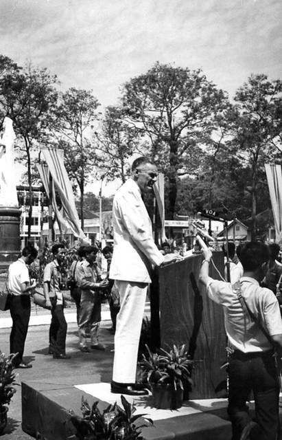 Ambassador Lodge standing at a podium giving a speech
