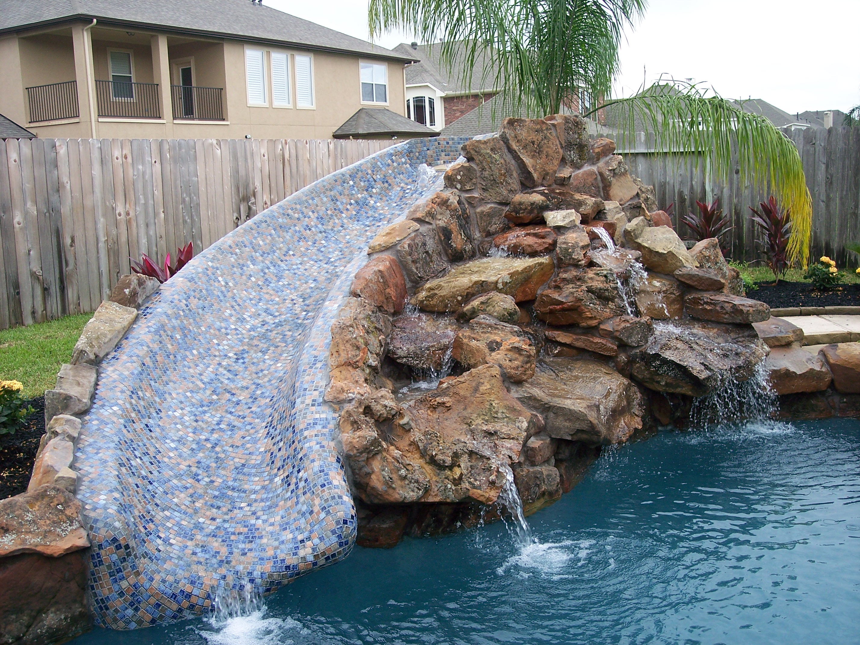 Pool Slide With Rock Waterfall Decorative Pools And