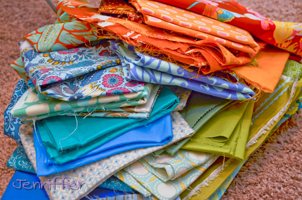 Pile of fabrics left to cut for AMH Quilt
