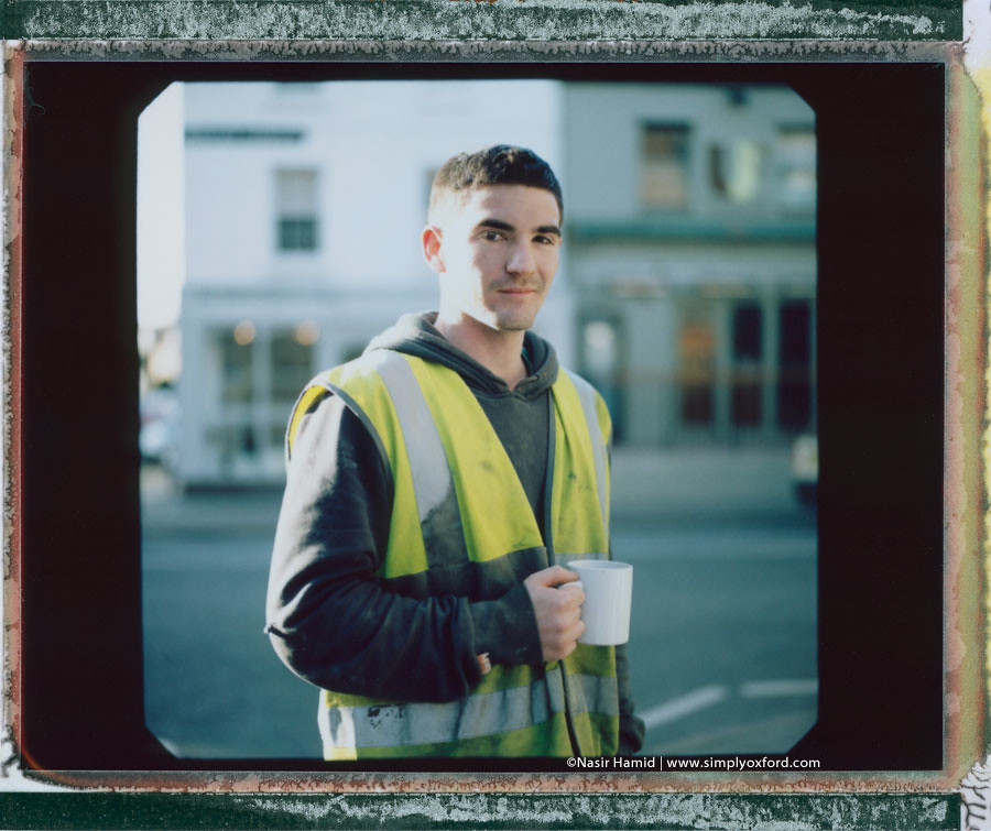 A builder holding a cup of tea