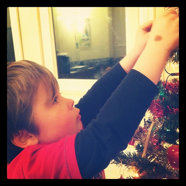 Max hanging up Christmas baubles. MAX. #sqwee #autism #neverthoughtidseetheday