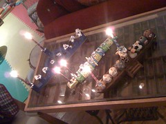 Three menorahs, one candle each